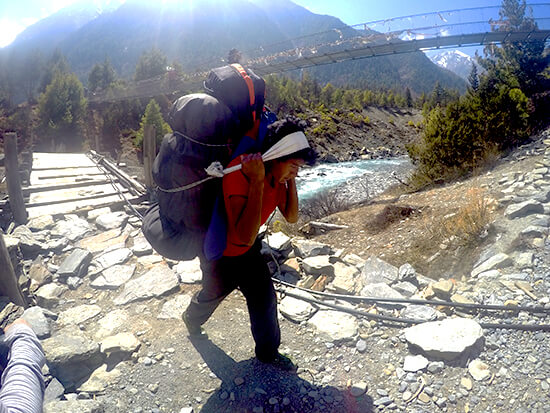 Sherpa carrying gear on Annapurna Circuit Trek