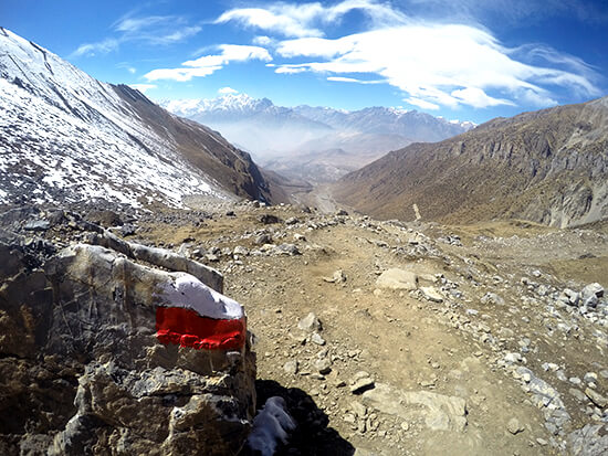 Red and white Trail marker signs on Annapurna Circuit